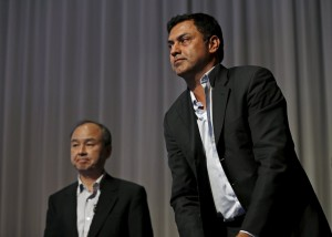 SoftBank Corp. Chief Executive Masayoshi Son (L) and Nikesh Arora, former Google chief business officer and currently SoftBank Vice Chairman, leave a news conference in Tokyo May 11, 2015. Son said on Monday that Vice Chairman Nikesh Arora was a strong candidate to lead the Japanese telecommunications and Internet conglomerate in the future. REUTERS/Issei Kato